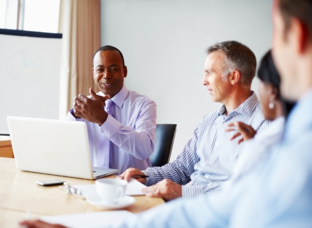 Executives in board room excited about proposal