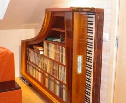 repurposed piano book case1 Trash to Treasure: 40 Creative Recycled and Repurposed Artworks