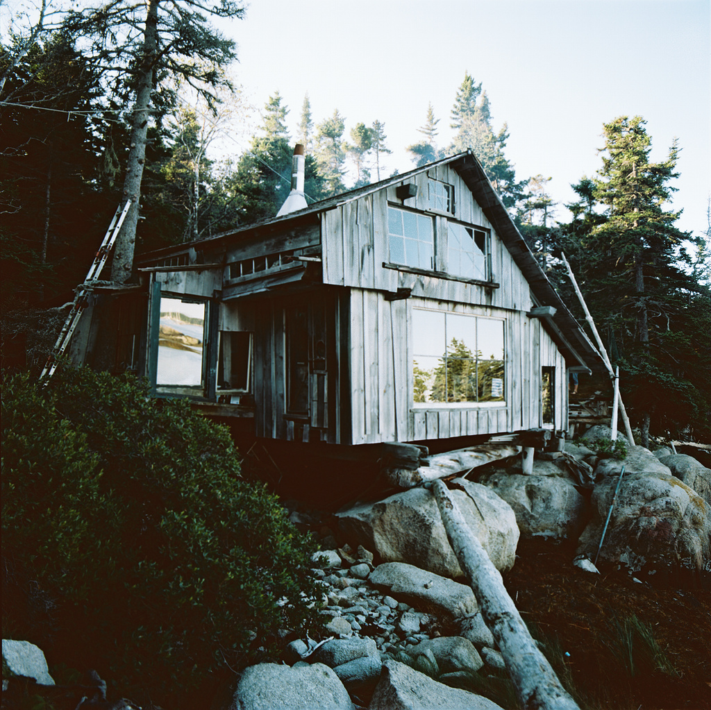 Cabin with driftwood stairs in Maine.