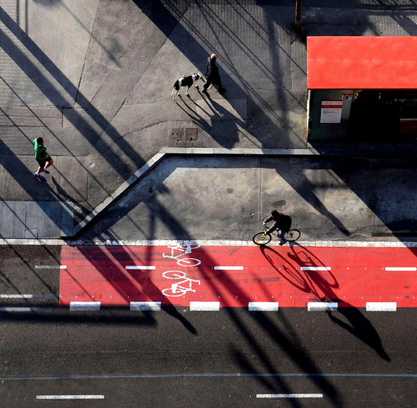 with legs with dog with bike 25 Remarkable Examples Of Shadow Photography