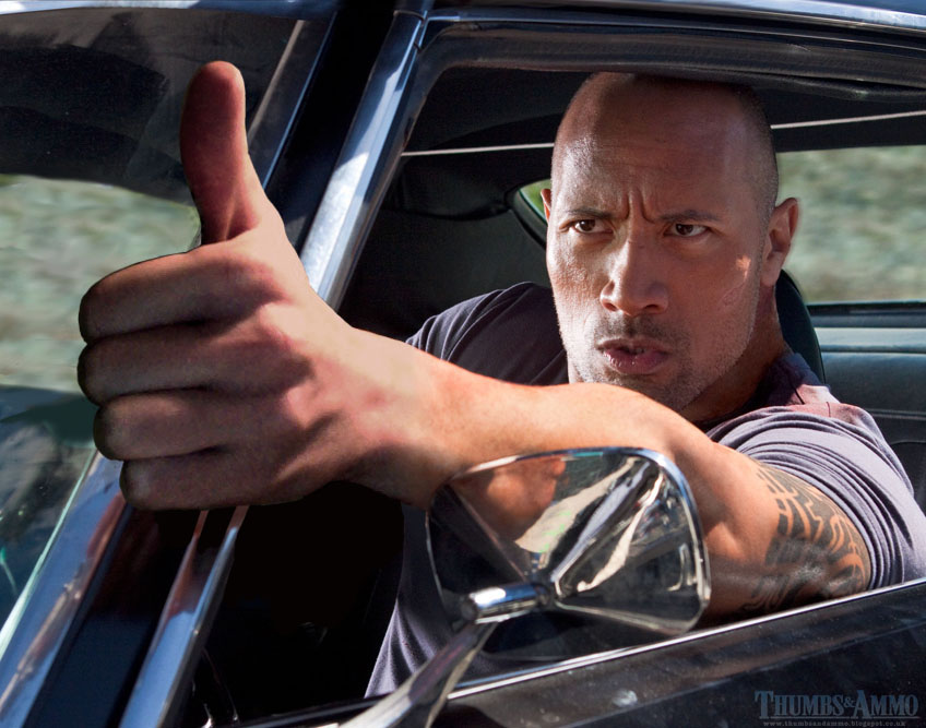 dwayne the thumb johnson Movie Scene Guns replaced with a 'Thumbs Up'