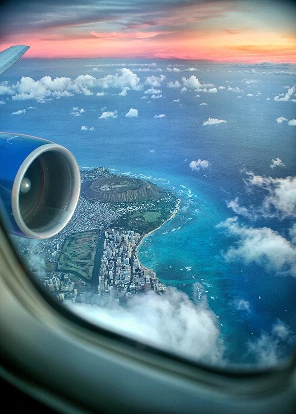 Airplane city sunset view