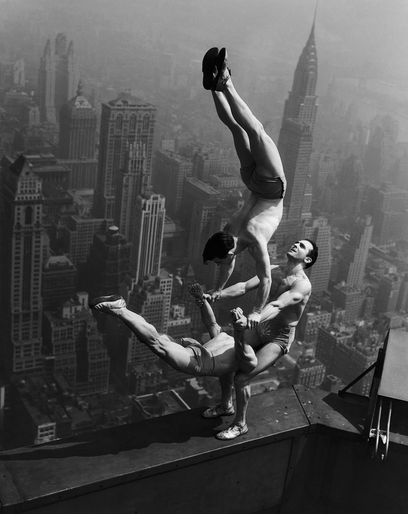 Acrobats balance on top of the Empire State Building