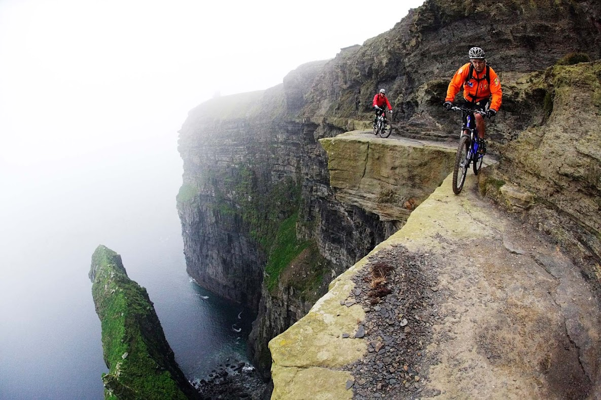 Bikers dangerously close to the cliff's edge