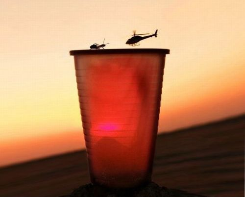 Helicopter vs ant on top of cup mountain