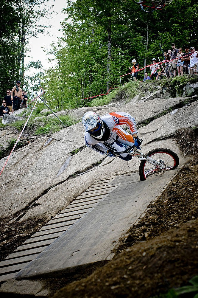 Downhill mountain biker, mid crash