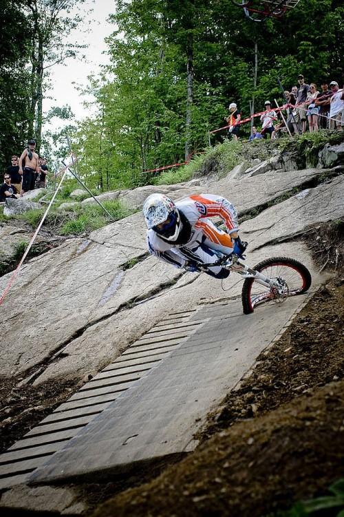 Downhill mountain biker, mid crash