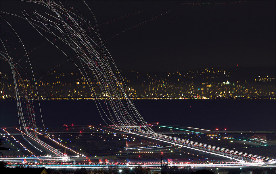 Plane Light Trails by Terence Chang