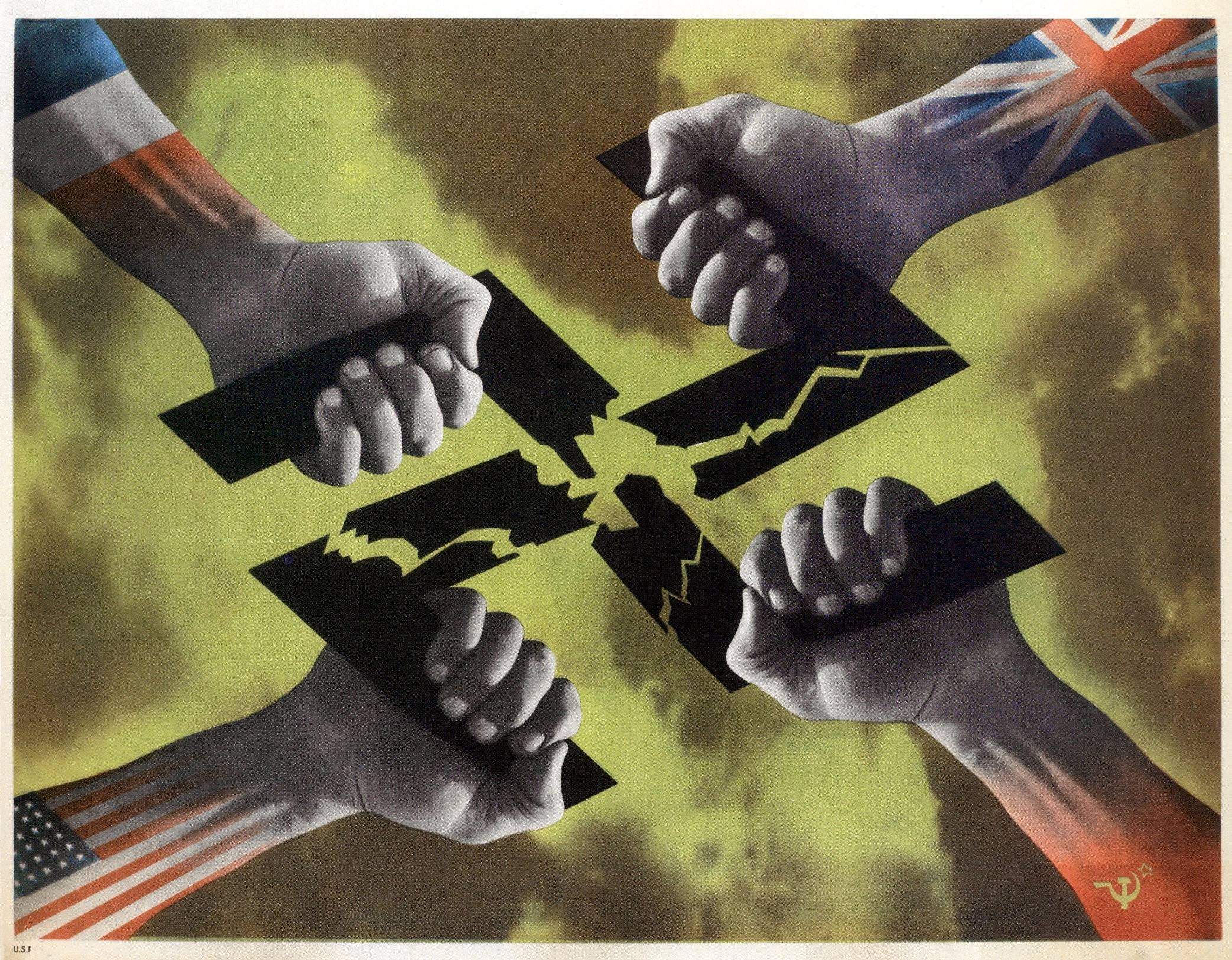 The fists of the Allies breaking the Nazi swastika, France, 1945