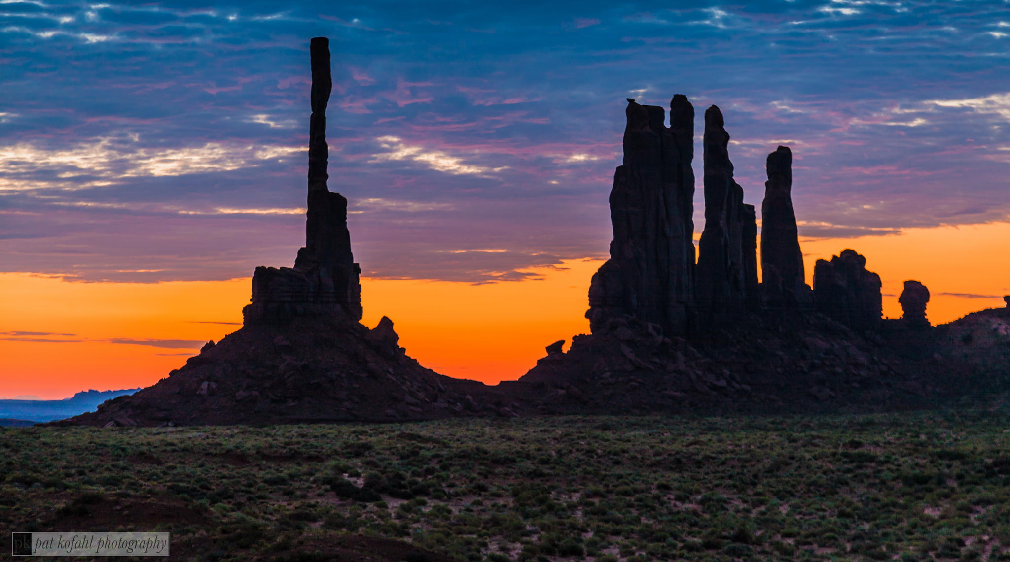 Totem Pole and Yei bi Chei formations at Monument Valley in Arizona by Pat Kofahl