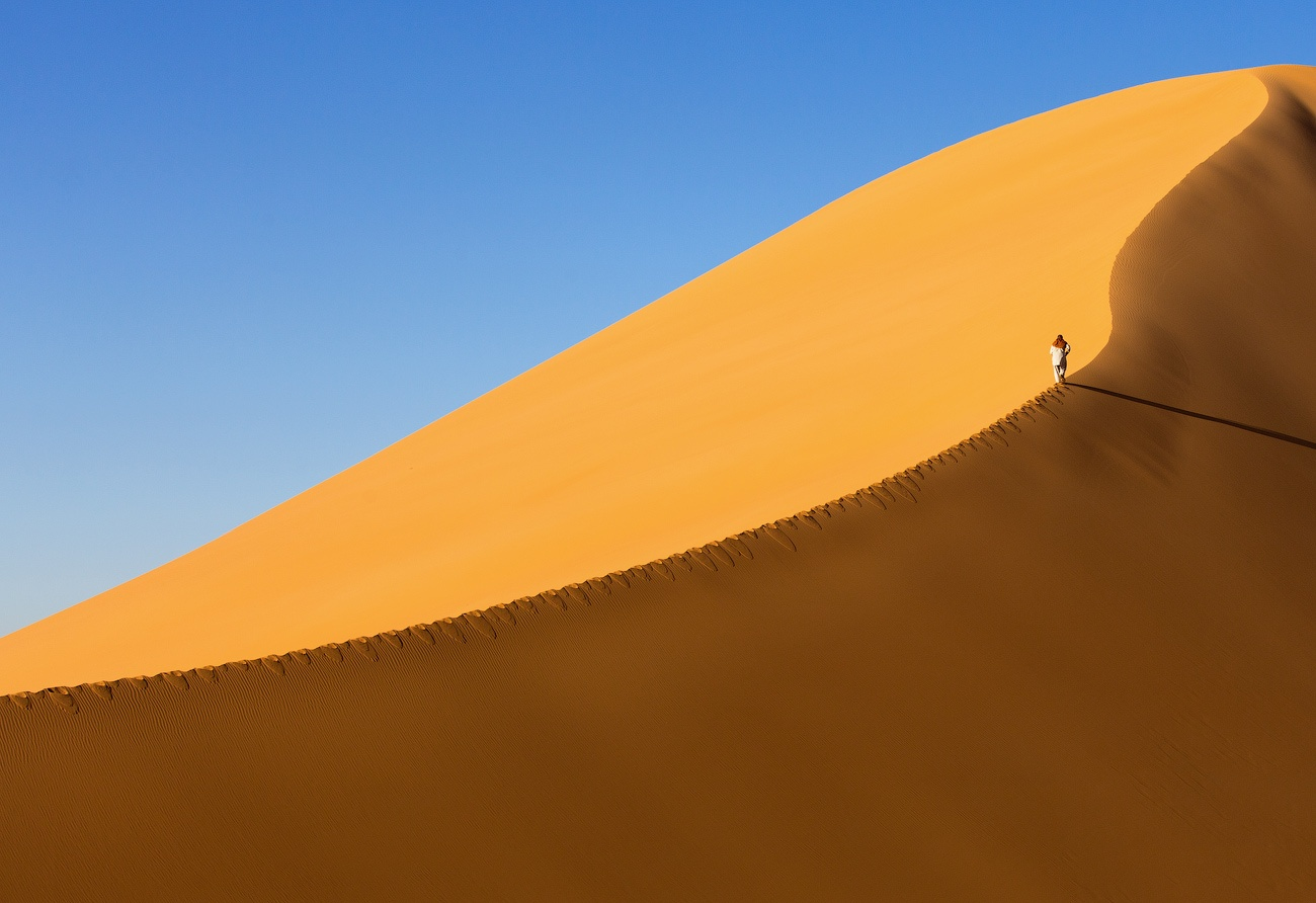 Walking along a dune in the Sahara by Victoria Rogotneva
